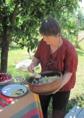 Karen feeding the hungry workers with wonderful food from their Salt Spring Island home garden