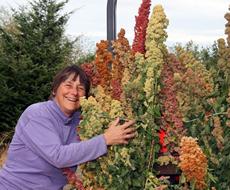 Karen with grain grown in their garden